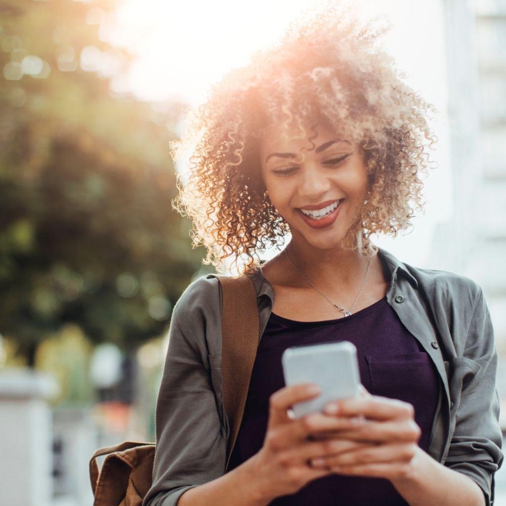 Girl outside on a smart phone
