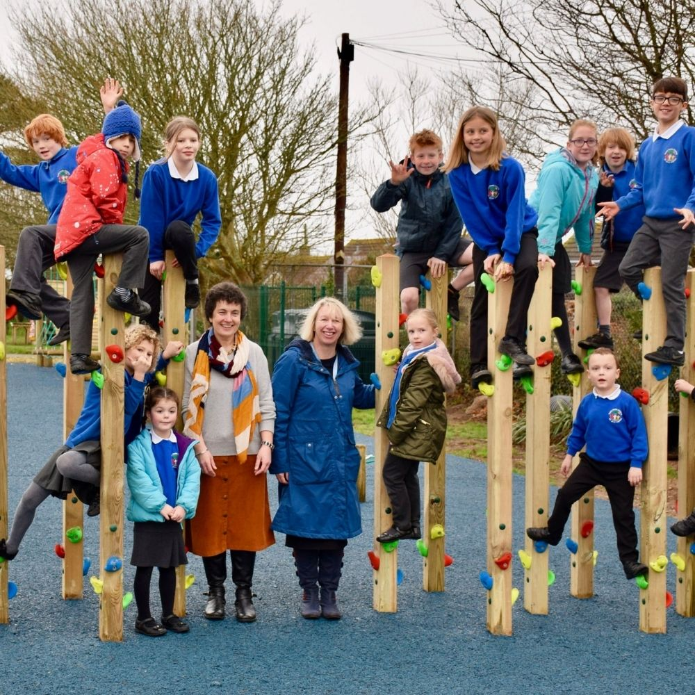 Children with teacher on an outdoor play area