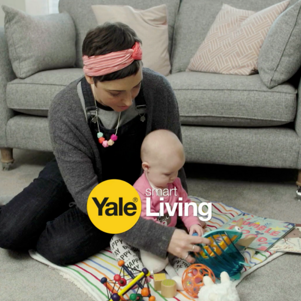 a lady playing on the floor with her baby a stills shot from a video produced for Yale
