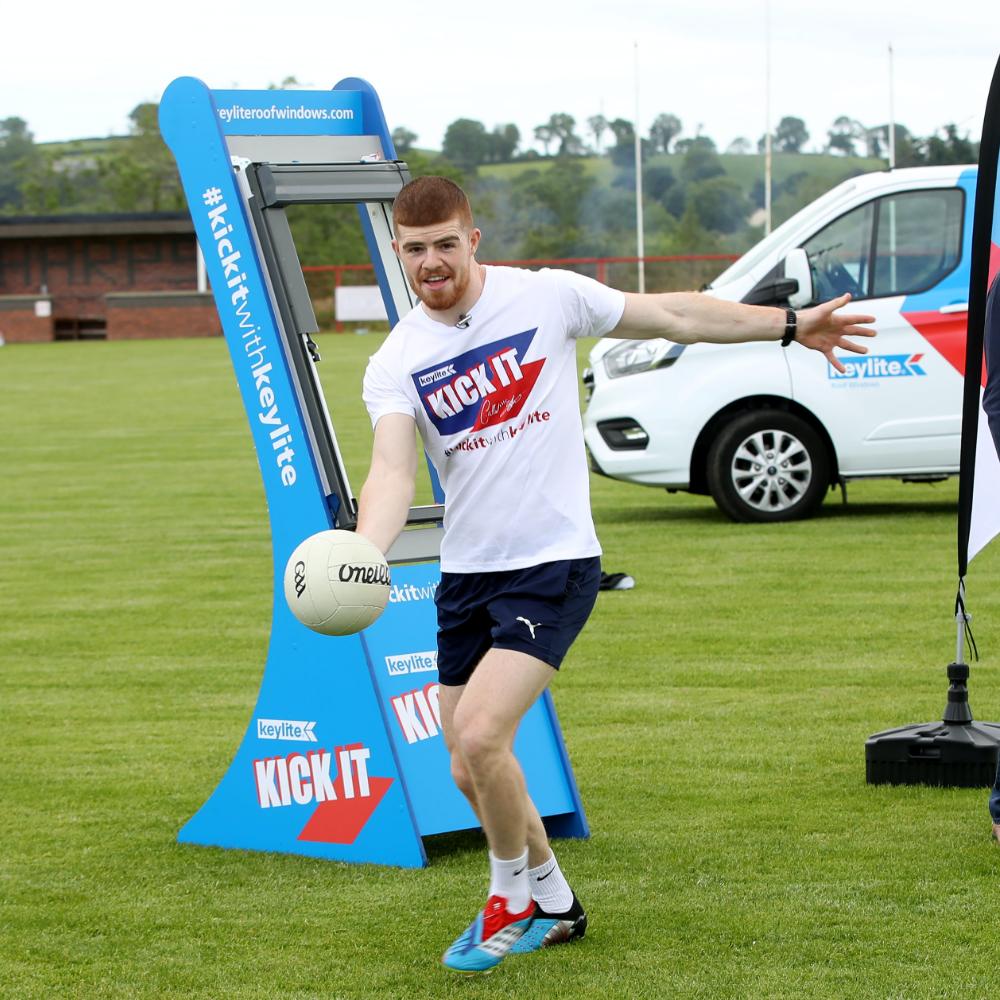 Cathal McShane kicking a football
